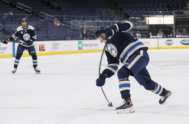 Blue Jackets forward Patrik Laine blasts a one-timer from the top of the face-off circle for a power-play goal in the first period of a 6-5 loss to Carolina on Sunday.