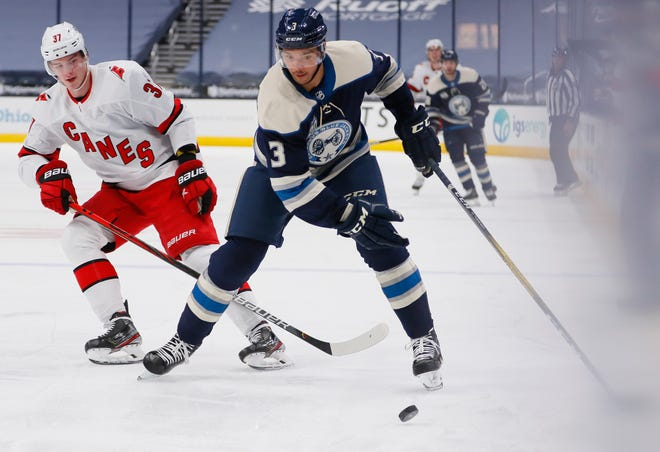 Blue Jackets defenseman Seth Jones, moving the puck around Carolina's Andrei Svechnikov on Feb. 7, becomes a pending unrestricted free agent July 28.