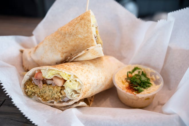 The falafel sandwich features homemade garbanzo and faza bean fritters with lettuce, tomato, onion, pickle and tahini sauce or hummus for $7.50.
