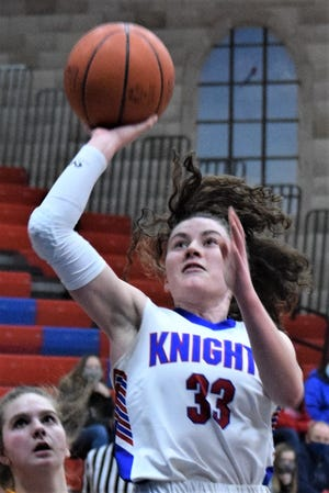 Katie Sprang rises up for a shot during recent action at West Holmes. Sprang is leading the Knights in scoring and hopes to help restore the luster to one of the storied programs on the area hardwoods.