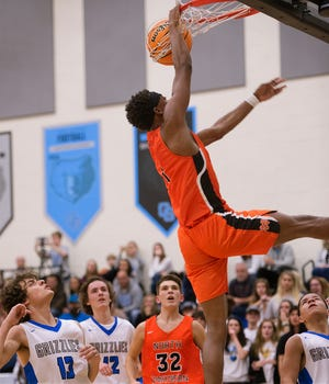North Davidson's Jamarien Dalton slam dunks the ball while watched by Oak Grove's Noah Richey and Ethan Whitaker, North Davidson's Mason Everhart, and Oak Grove's Kahleb Craven (from left) on Dec. 17, 2019. Dalton and the Black Knights will be playing Salisbury for the CCC championship on Tuesday. [Donnie Roberts/The Dispatch]
