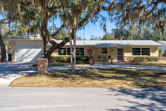 This lovely pool home in Ormond Beach is surrounded by a huge yard that gives the feeling of country living in the city.