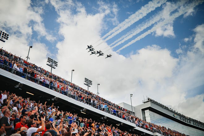 Fans watch as the Thunderbirds roar overhead as the National Anthem concludes before the start of the 2020 Daytona 500 at Daytona International Speedway on Feb. 16, 2020.