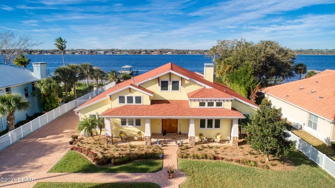 This custom-built pool home is situated on an amazing lot, with 100 feet on the Intracoastal Waterway.