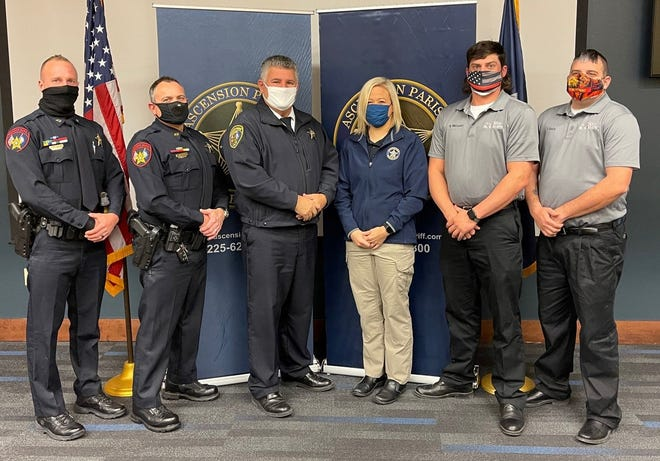 Ascension Parish Sheriff Bobby Webre poses with deputies Daniel Haydel, Jamie Wolfe, Karly Gutierrez, and Sorrento firefighters Shane Wellman and Jeff Kelly. The sheriff and parish officials honored the five responders for their heroic efforts in responding to a submerged vehicle in St. Amant.