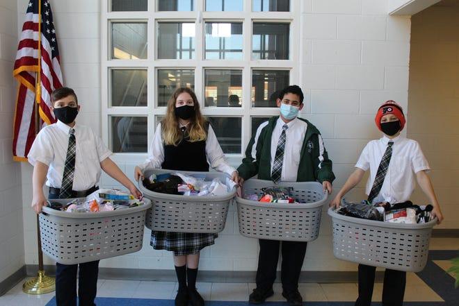 From left, eighth-graders Vasco Granitto, Katie Mancuso, Mark Younan and Colin Burke.