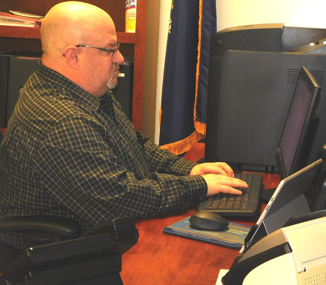 New Little Falls Police Chief Robert Thomas works in his office at Little Falls City Hall.