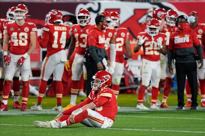 Kansas City Chiefs quarterback Patrick Mahomes (15) sits on the turf following a failed pass attempt in the second half of Super Bowl 55. Mahomes, who was under constant pressure, was just 4 of 12 on third down in the 31-9 loss to the Buccaneers.