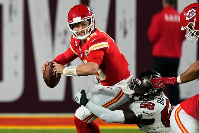 Tampa Bay Buccaneers outside linebacker Shaquil Barrett sacks Chiefs quarterback Patrick Mahomes during the second half of Super Bowl 55 Sunday in Tampa. Mahomes rarely had time to throw behind a makeshift offensive line in the 31-9 loss.
