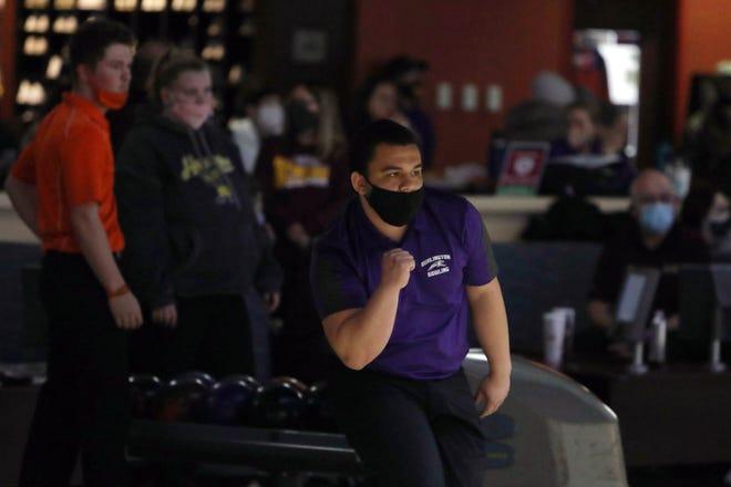 Burlington High School Machias Perez reacts as he bowls a frame during the Southeast Conference bowling at KingPins, Monday Feb. 8, 2021 in Burlington.
