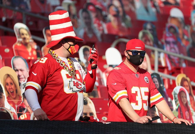 Kansas City Chiefs fans look over the field before the start of Super Bowl LV at Raymond James Stadium in Tampa, Fla., on Sunday, Feb. 7, 2021.