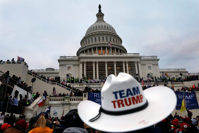 Supporters of President Donald Trump protest on the steps of the U.S. Capitol building on Capitol Hill in Washington, D.C., on Wednesday, Jan. 6, 2021.