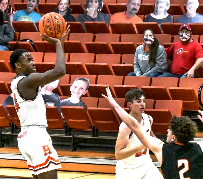 Holcomb's Zephyn Mason goes up for a basket against Ulysses Jan. 8 at Holcomb. Mason led the Longhorns to victory Friday at Goodland, scoring 17 points.
