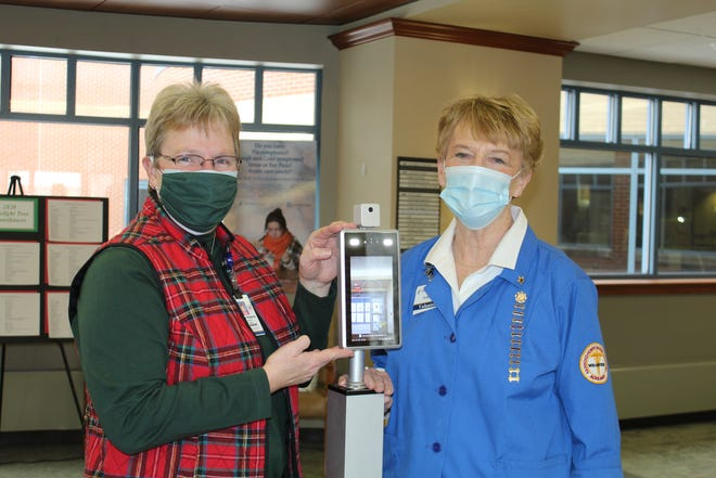 Darcy Hepner, left, Hammond-Henry Hospital Foundation manager; and Judy Deutsch, Foundation Annual Support Committee member, show one of the two temperature scanners purchased for the hospital with funds from the Foundation's 2020 Giving Project.