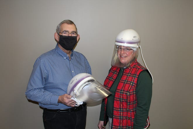 Jim Unrath, left, chairman of the Hammond-Henry Hospital Foundation Annual Support Committee; and Darcy Hepner, show the CAPR helmets which were purchased with funds from the Foundation's Giving Project.