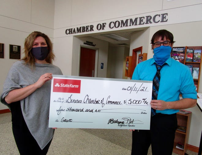 Bethany Winkleman, president of the Geneseo Chamber of Commerce and owner of the Winkleman's State Farm Agency in Geneseo; and Zack Sullivan, executive director of the Geneseo Chamber of Commerce, show a mock check in the amount of $5,000 which is the amount of the grant the Geneseo Chamber recently received to support its Lunch and Learn Program.