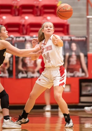 Glen Rose's Hannah Cantwell swats the ball away for a steal on Friday night in the Lady Tigers' win over Gatesville.