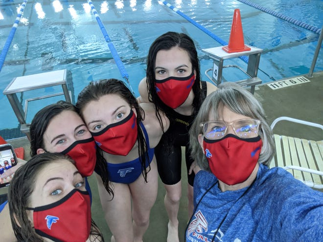 West Henderson's girls swimmers and their coach, Kelly Littauer, right, pose following Saturday's regional meet in Huntersville. From left to right are Maggie Dotti, Emory Hogan, Shannon Lail and state qualifier Ava Kilpatrick.