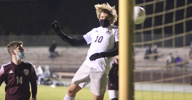 Croatan's Travis Garner-McGraw scores a goal during a game at Dixon earlier this season. [Chris Miller / The Daily News]