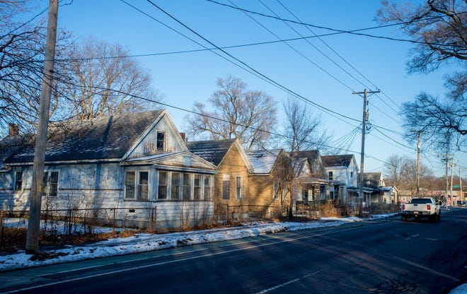 A row of abandoned and dilapidated houses line a section of Lincoln Avenue on Peoria's South Side.