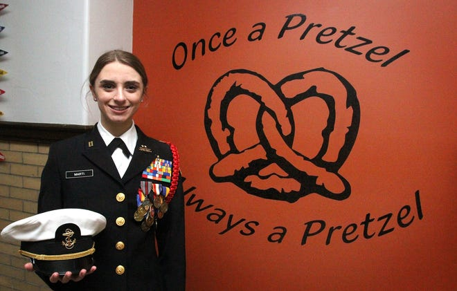 MacKenzie Marti, a senior and member of the NJROTC at Freeport High School, is all smiles Saturday, Feb. 6, 2021, as she stands in front of the school motto sign after receiving word from U.S. Rep. Cheri Bustos of her appointment to the United States Air Force Academy.