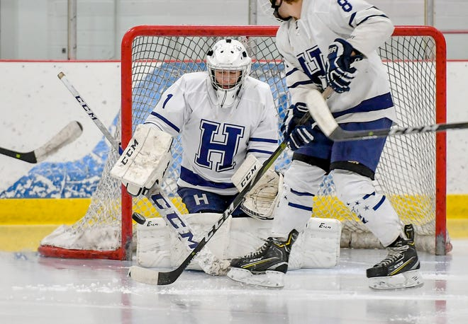 Hudson goaltender Ben Cole makes a save during a game agaisnt Strongsville earlier this season.
