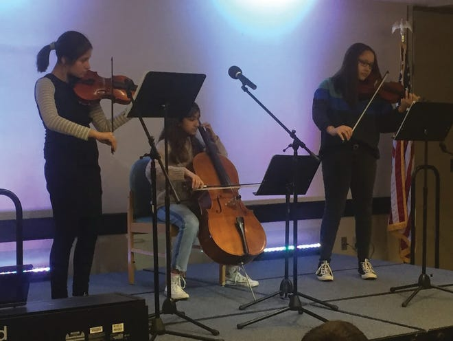 """At last year's Coffee for a Cause, Aimee Flores, Shyliss Ruffin and Amy Dokiburra played """"Yesterday"""" by The Beatles at Twinsburg Library. This year, the fundraiser event will be a virtual one on March 27."""