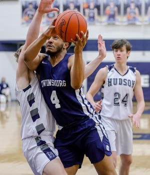 Twinsburg forward Roman Sims fights up a shot during the Tigers' 54-30 loss at Hudson Saturday