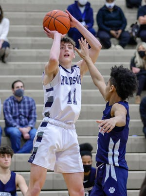 Hudson's Jack Whitman shoots a three during the Explorers' 54-30 home win over Twinsburg Saturday