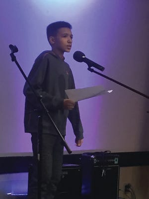 Damon Hoody read original poetry at last year's Coffee for a Cause at the Twinsburg Library. This year's fundraiser for Akron Children's Hospital will be a virtual one on March 27.