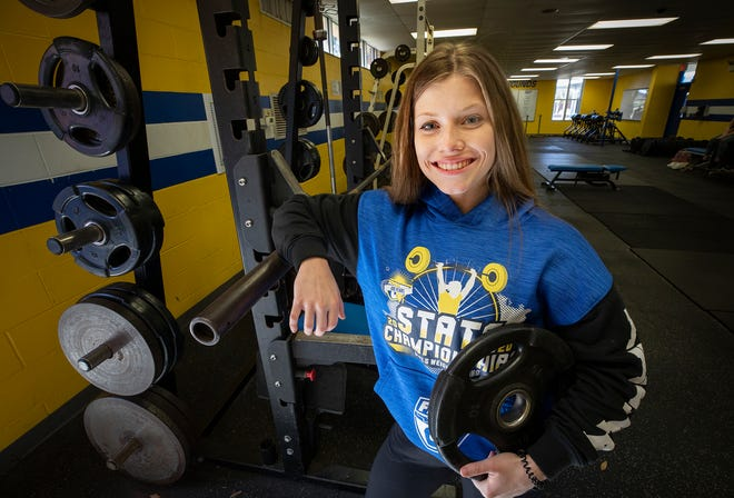 Auburndale girls weightlifter Emily Hart set a state record at a region meet and will be competing for a state title this weekend.