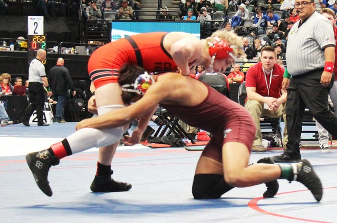 Swink High School's Matthew Mendoza (right) attempts to take down Centauri's Zach Buhr at last year's state tournament. Mendoza is ranked second at 160 pounds in Class 2A in this week's On the Mat rankings.
