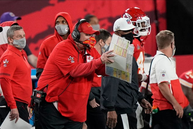 Kansas City Chiefs' Andy Reid works during the first half of the NFL Super Bowl 55 football game against the Tampa Bay Buccaneers Sunday, Feb. 7, 2021, in Tampa, Fla.