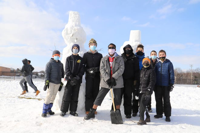 Students from McQuaid Jesuit Middle School create snow sculptures to brighten the day for children with complex medical conditions at Daystar Kids.