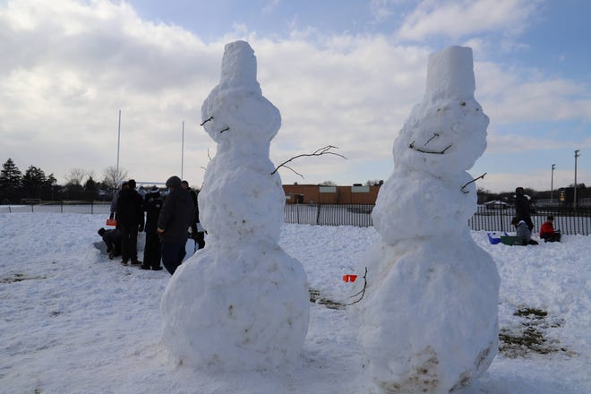 McQuaid Jesuit Middle School theology students build snow sculptures outside of Daystar Kids, a pediatric day respite center in Brighton.