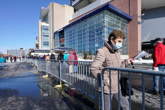 People enter a socially distanced line to get their COVID-19 vaccinations at Gillette Stadium, Monday, Feb. 8, 2021, in Foxborough, Mass. (AP Photo/Steven Senne)