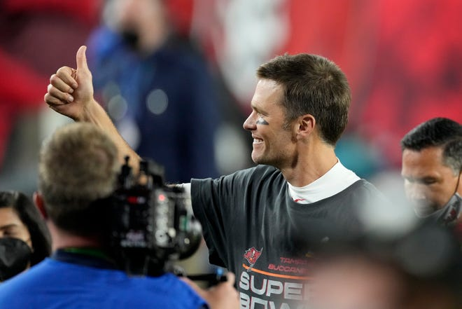Tampa Bay Buccaneers quarterback Tom Brady walks off the field after the NFL Super Bowl 55 football game against the Kansas City Chiefs in Tampa, Fla. The Buccaneers defeated the Chiefs, 31-9, to win the Super Bowl last year.