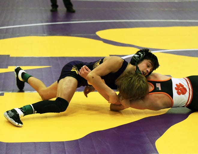 Nevada's Kaden Weber tries to turn Grinnell's Dylan Heater during the championship round of the Class 2A sectional meet in Nevada Saturday. Weber defeated Heater by a 3-1 decision to take first at 106 pounds and advance to districts.