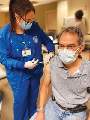 Orthopedic surgeon Jean Francois Reat receives the first of his two COVID-19 vaccinations during a vaccination clinic in December for Methodist Medical Center ofOak Ridge employees. A total of 8.43% of Tennesseans have reportedly received their first of two vaccinations for the novel coronavirus.