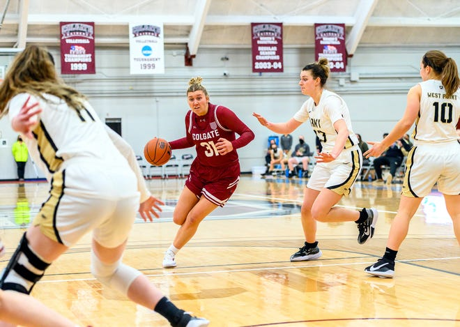 Colgate women's basketball team forward Alexa Naessens (31) moves in for a shot Jan. 31 against Army. The Raiders had both of this past weekend's games against Boston University postponed because injuries brought them below the NCAA-mandated minimum number of available players.