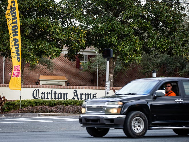 A motorist passes by the Carlton Arms apartment complex on Monday in Ocala. The owner of the Carlton Arms says the new system to pay for fire service is unfair, and is suing the city of Ocala. [Doug Engle/Ocala Star-Banner]