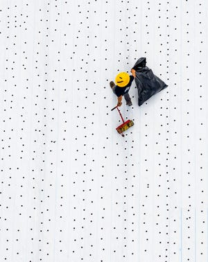"""A roofing contractor pulls a roller behind him Feb. 8 while installing rolled roofing on the Marion County Sheriff's Office Forensic and Evidence building project. Nonfarm employment in the Ocala metro was 108,100 in February, """"a decrease of 1,700 jobs (-1.5 percent) over the year but an increase of 700 compared to January's preliminary report,"""" CareerSource Citrus Levy Marion noted in a news release."""