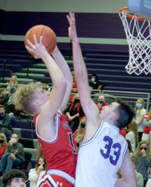Ottawa High School junior Noah McCullough has taken his game to a different level in the past few games, aggressively taking the ball to the basket.