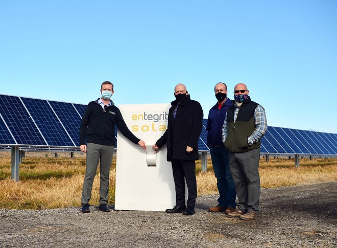 """Entegrity's Sam Selig (left) is seen with Alma Mayor Jerry Martin, Alma Public Works Director Mark Yardley, and District 5 Justice of the Peace Raymond Harvey at the """"Flip the Switch"""" ceremony on Feb. 5. The event commemorated powering on Alma's new solar array that will make use of a brownfield site and create local jobs."""
