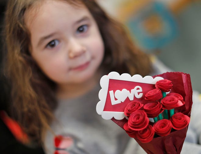 Corina D'Andrea, 5 of Weymouth holds a bouquet of paper flowers on Feb. 8, 2021. Children at the Hanover Nursery School in Rockland made the Valentines for nursing home residents at Webster Park in Rockland.