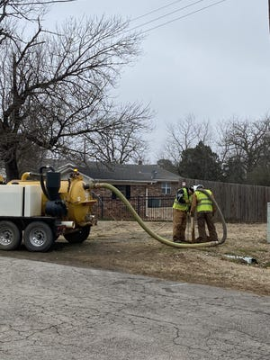 Patriot Underground workers use high-pressure water to locate utility lines.