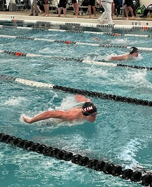 Pekin co-op's Lucas Glesne swims the butterfly leg of the 200 IM during a meet at Normal West.