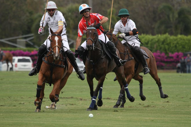 La Indiana teammates Polito Pieres (left) and Jeff Hall try to defend Scone 10-goaler Adolfo Cambiaso during Sunday's match at Grand Champions Polo Club
