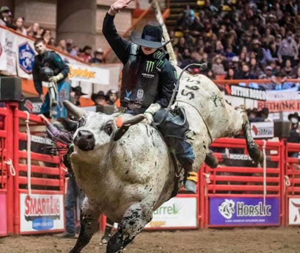 J.R. Stratford of Byers, Kansas rides High Expectations, setting an arena record at 93 during the PRCA Rodeo Rapid City competition  this past weekend in South Dakota.