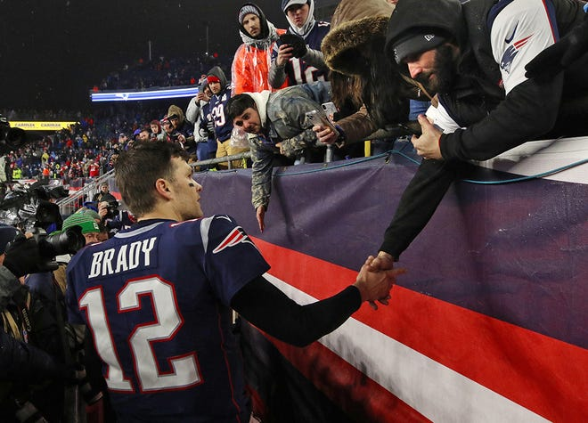 Tom Brady walks off the field at Gillette Stadium for the final time as Patriots quarterback following a playoff loss in January 2020.